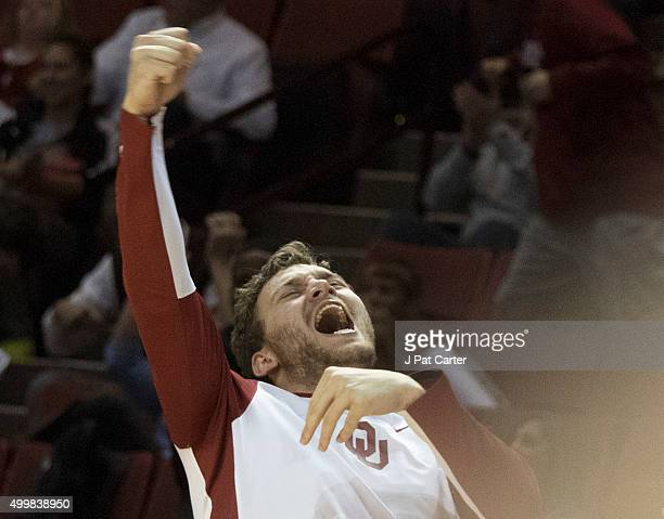 J Cole of the Oklahoma Sooners celebrates as Oklahoma leads against Central Arkansas during the second half of a NCAA college basketball game against...