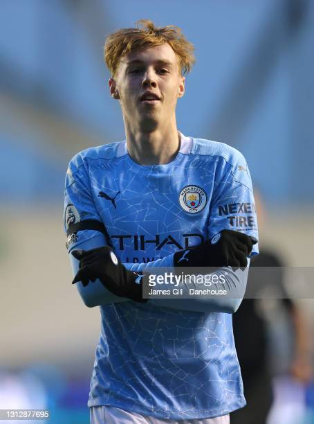 Cole Palmer of Manchester City celebrates after scoring their third goal during the Premier League 2 match between Manchester City and Manchester...