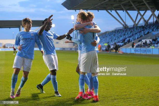 Cole Palmer of Manchester City celebrates with team mates after scoring their third goal during the Premier League 2 match between Manchester City...