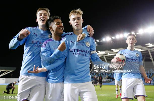 Cole Palmer of Manchester City celebrates with teammates after scoring his teams fifthg goal during the Under 18's Premier League 2 Cup Final at The...