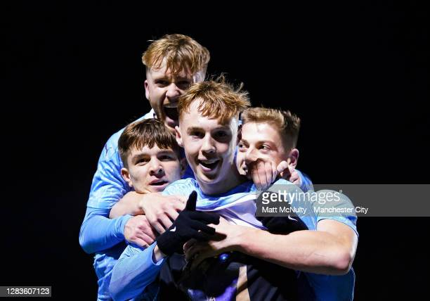Cole Palmer of Manchester City celebrates with teammates after scoring his teams third goal during the FA Youth Cup Final match between Manchester...
