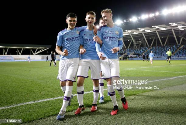 Cole Palmer of Manchester City celebrates with teammates Alex Robertson and James McAtee after scoring his teams sixth goal during the Under 18's...