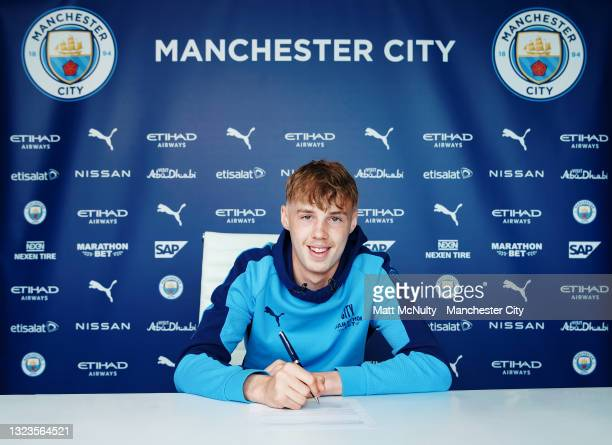 Cole Palmer of Manchester City signs a contract extension at Etihad Campus on June 14, 2021 in Manchester, England.