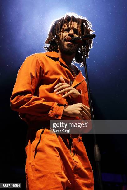 J Cole performs on stage at The O2 Arena on October 15 2017 in London England