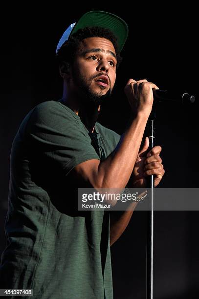 J Cole performs onstage at the 2014 Budweiser Made In America Festival at Benjamin Franklin Parkway on August 30 2014 in Philadelphia Pennsylvania