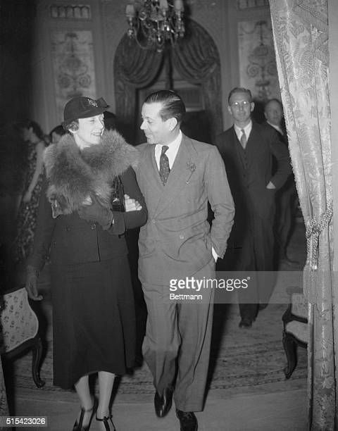 Cole Porter and wife leaving Victor Hugo's Cafe