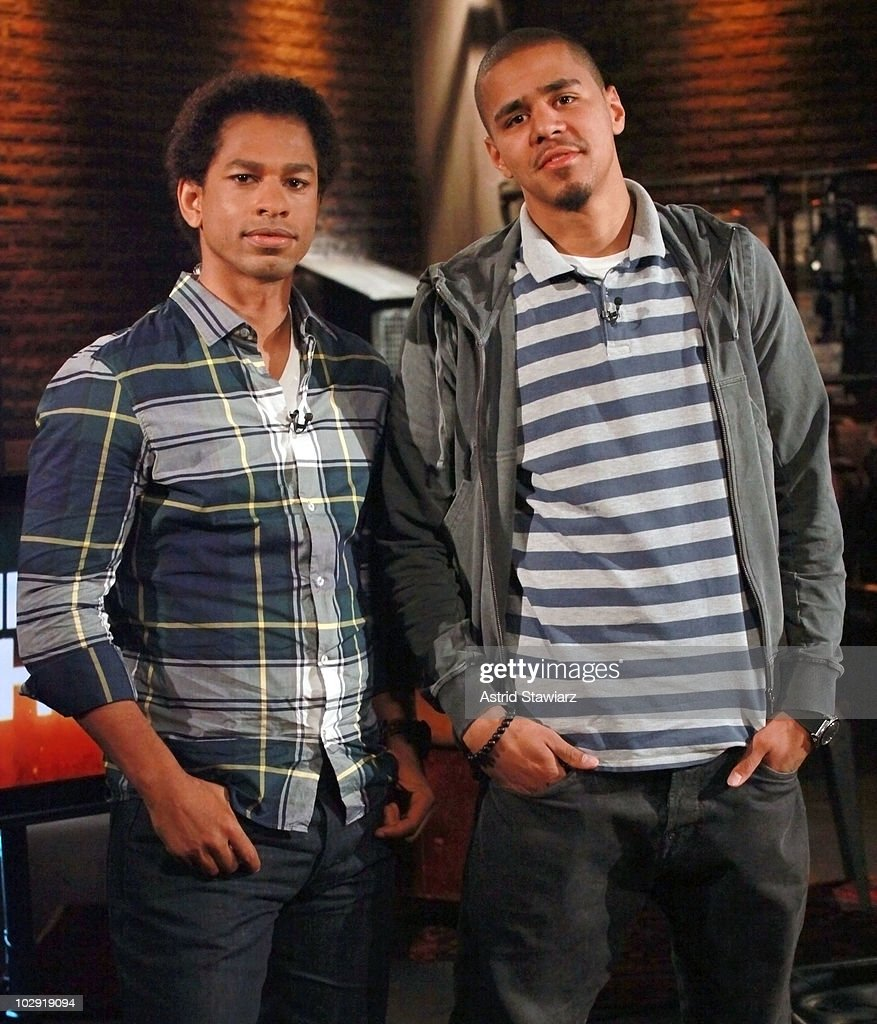 J. Cole (R) poses for photos with host of Fuse's 'Hip Hop Shop' Toure (L) during a taping of an episode, airing on July 21, 2010, at fuse Studios on July 15, 2010 in New York City.
