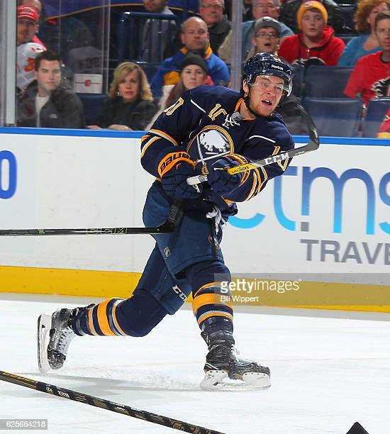 Cole Schneider of the Buffalo Sabres takes a shot against the Calgary Flames during an NHL game at the KeyBank Center on November 21 2016 in Buffalo...