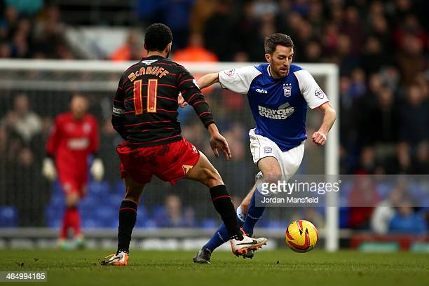 Cole Skuse of Ipswich Town takes the ball past Jobi McAnuff of Reading FC during the Sky Bet Championship match between Ipswich Town and Reading at...