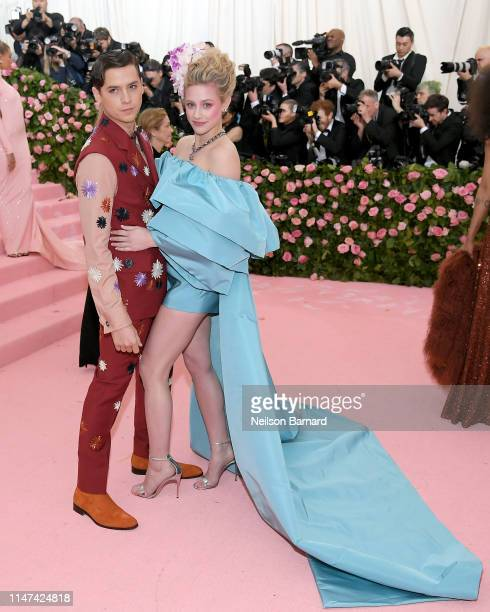 Cole Sprouse and Lily Reinhart attend The 2019 Met Gala Celebrating Camp Notes on Fashion at Metropolitan Museum of Art on May 06 2019 in New York...
