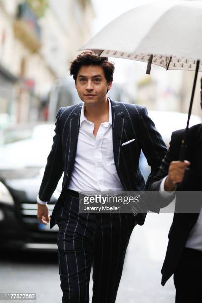 Cole Sprouse wearing a complete Thom Browne outfit on September 29, 2019 in Paris, France.