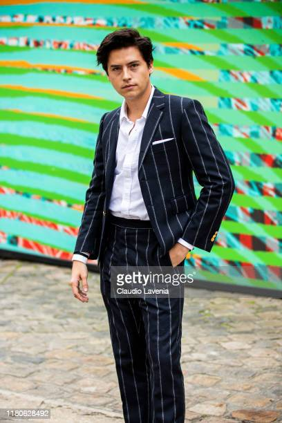 Cole Sprouse wearing a striped suit is seen outside the Thom Browne show during Paris Fashion Week Womenswear Spring Summer 2020 on September 29 2019...