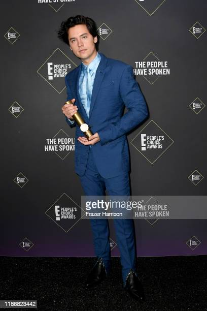 Cole Sprouse winner of Drama Movie Star of 2019 poses in the press room during the 2019 E People's Choice Awards at Barker Hangar on November 10 2019...