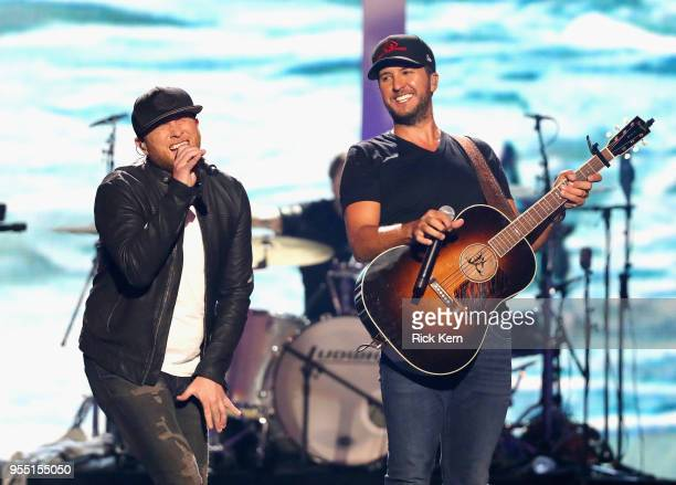 Cole Swindell and Luke Bryan perform onstage during the 2018 iHeartCountry Festival By ATT at The Frank Erwin Center on May 5 2018 in Austin Texas