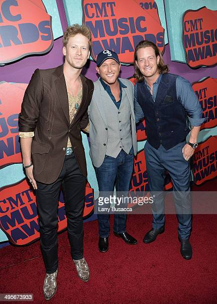 Cole Swindell poses with Brian Kelley and Tyler Hubbard of Florida Georgia Line at the 2014 CMT Music awards at the Bridgestone Arena on June 4 2014...