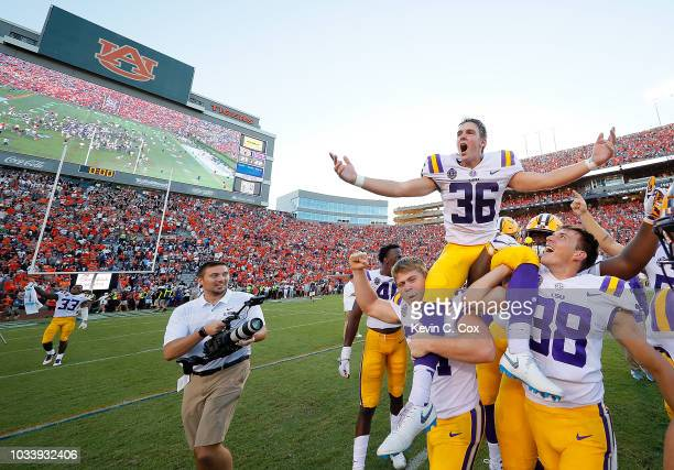 Cole Tracy of the LSU Tigers celebrates after kicking the gamewinning field goal in their 2221 win over the Auburn Tigers at JordanHare Stadium on...