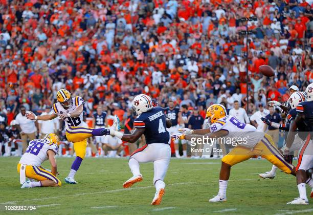 Cole Tracy of the LSU Tigers kicks the gamewinning field goal in their 2221 win over the Auburn Tigers at JordanHare Stadium on September 15 2018 in...