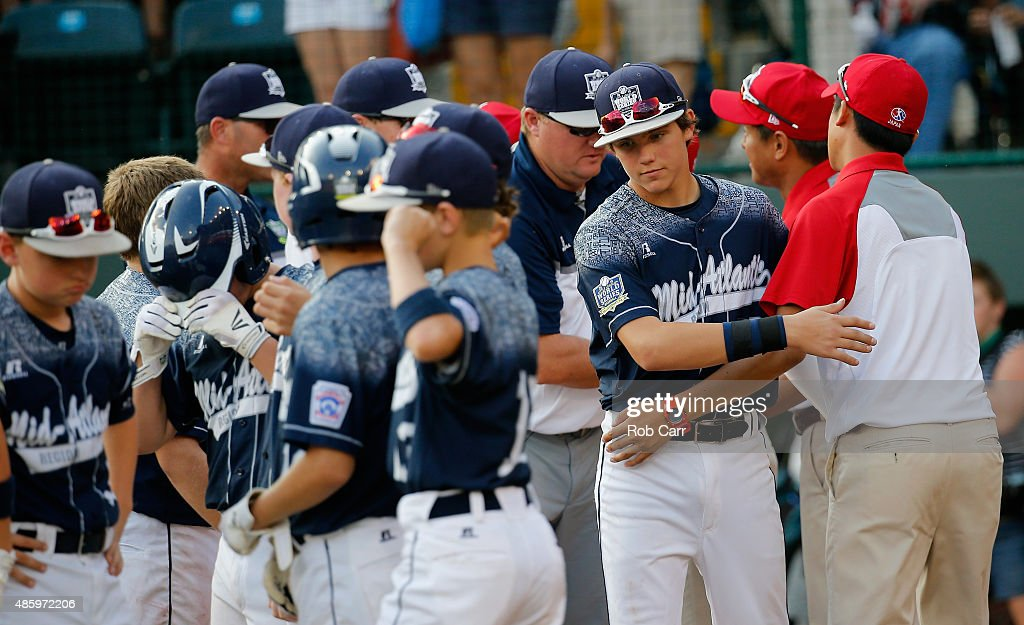 Cole Wagner #22 of the Mid-Atlantic team from Red Land Little League of Lewisberry, Pennsylvania shakes hands with team Japan following their 18-11 loss during the Little League World Series Championship game at Lamade Stadium on August 30, 2015 in South Willamsport, Pennsylvania.