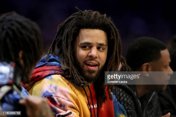 J Cole watches the action during the NBA AllStar game as part of the 2019 NBA AllStar Weekend at Spectrum Center on February 17 2019 in Charlotte...