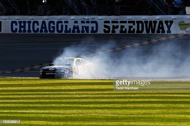 Cole Whitt, driver of the Degree Men Chevrolet, spins across the infield after a tire issue during the NASCAR Nationwide Series Dollar 300 at...