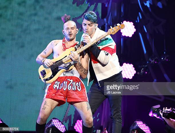 Cole Whittle and Joe Jonas of DNCE perform during the KIIS FM's Jingle Ball 2015 presented by Capital One on December 4 2015 in Los Angeles California