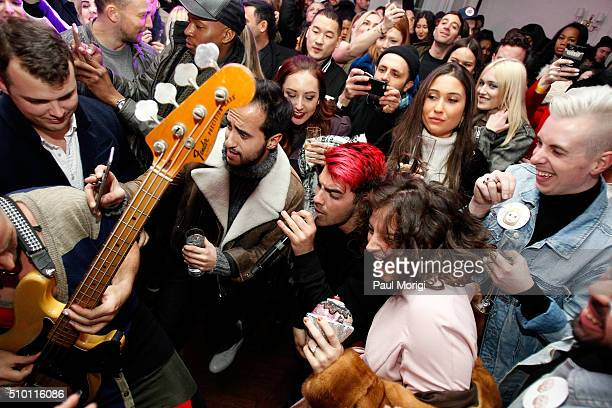 Cole Whittle and Joe Jonas of DNCE perform in the audience at the after party celebrating DIESEL's Madison Avenue flagship on February 13 2016 in New...