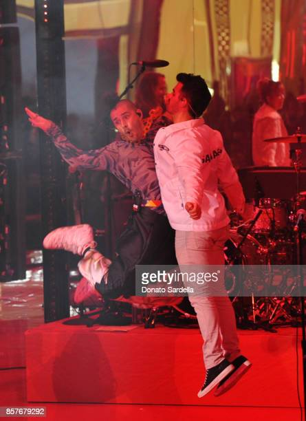 Cole Whittle and Joe Jonas of DNCE perform onstage at the Westfield Century City Reopening Celebration on October 3 2017 in Century City California