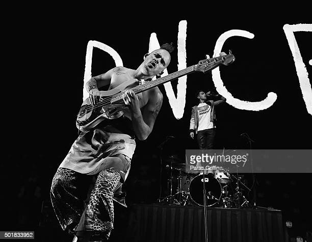 Cole Whittle and Joe Jonas of the band DNCE perform onstage during Power 961's Jingle Ball 2015 at Philips Arena on December 17 2015 in Atlanta...