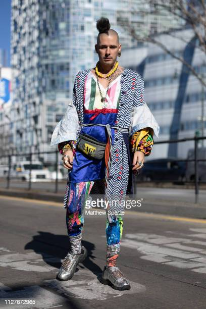 Cole Whittle is seen on the street during Men's New York Fashion Week wearing thrifted tights, sushi chef apron, silk handmade down blouse, thrifted...