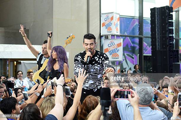 Cole Whittle JinJoo Lee and Joe Jonas of the band DNCE perform on NBC's Today at Rockefeller Plaza on August 26 2016 in New York City