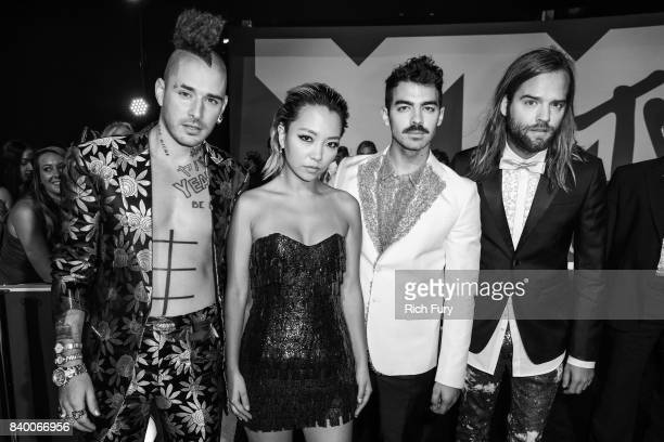 Cole Whittle JinJoo Lee Joe Jonas and Jack Lawless of music group DNCE attend the 2017 MTV Video Music Awards at The Forum on August 27 2017 in...