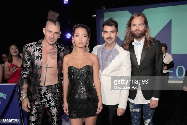 Cole Whittle JinJoo Lee Joe Jonas and Jack Lawless of musical group DNCE attend the 2017 MTV Video Music Awards at The Forum on August 27 2017 in...