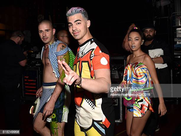 Cole Whittle Joe Jonas and JinJoo Lee of musical group DNCE attend Nickelodeon's 2016 Kids' Choice Awards at The Forum on March 12 2016 in Inglewood...