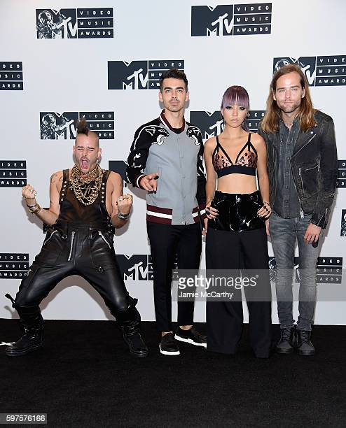Cole Whittle Joe Jonas JinJoo Lee and Jack Lawless of DNCE attend the Press Room at the 2016 MTV Video Music Awards at Madison Square Garden on...