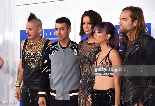 Cole Whittle Joe Jonas JinJoo Lee Jack Lawless of DNCE with Ashley Graham attend the 2016 MTV Video Music Awards at Madison Square Garden on August...