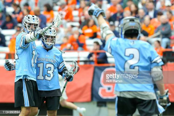 Cole Williams of the Johns Hopkins Blue Jays celebrates his goal with teammate Kyle Marr while gesturing to teammate Alex Concannon against the...