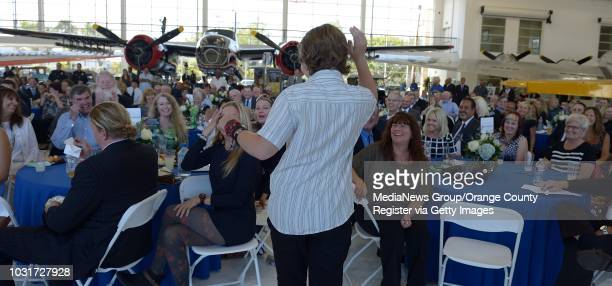 Cole Worthington son of famed car salesman Cal Worthington, acknowledges the crowd during Cal Worthington's memorial service at Lyons Air Museum in...