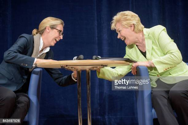 Colead candidate Alice Weidel speeks with former Christian Democrat Erika Steinbach during an AfD election campaign event on September 6 2017 in...