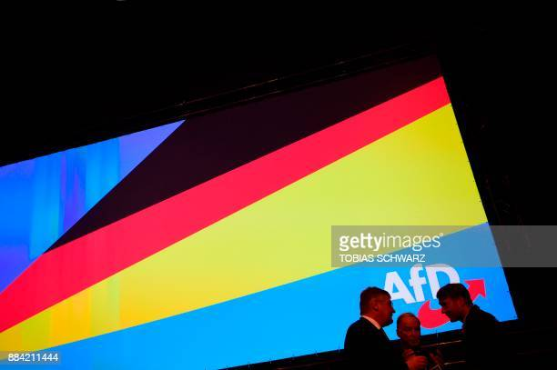 Coleader of the Alternative for Germany farright party's parliamentary group Alexander Gauland talks with a member of the party's leadership Andre...