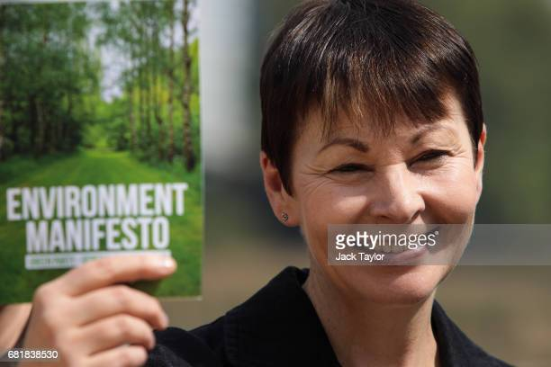 CoLeader of the Green Party Caroline Lucas holds up the party's environmental manifesto during the launch at the Woodberry Wetlands nature reserve on...