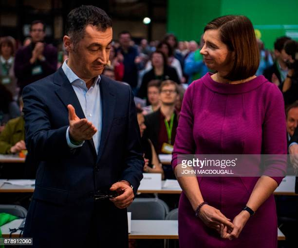 Coleader of the Green party Cem Ozdemir and parliamentary group coleader of the Green party Katrin GoeringEckardt chat during an extraordinary Green...