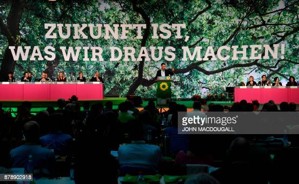 Coleader of the Greens ecologist party Cem Ozdemir addresses delegates during an extraordinary Green party congress to discuss the collapse of...