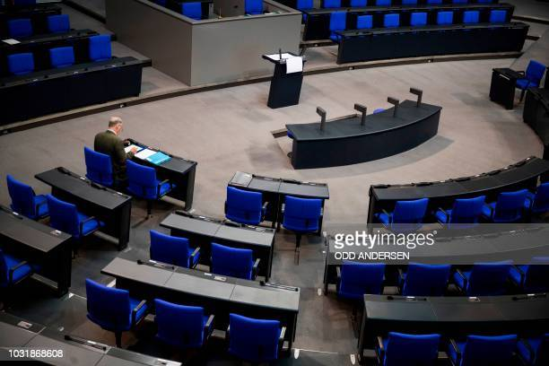 Co-leader of the parliamentary group of the Alternative for Germany far-right party Alexander Gauland sits alone preparing his speech in the plenary...