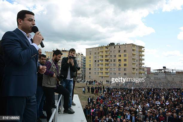 Coleader of the proKurdish Peoples' Democratic Party Selahattin Demirtas speaks as Kurds gather for Nowruz celebrations at Silvan in Diyarbakir...