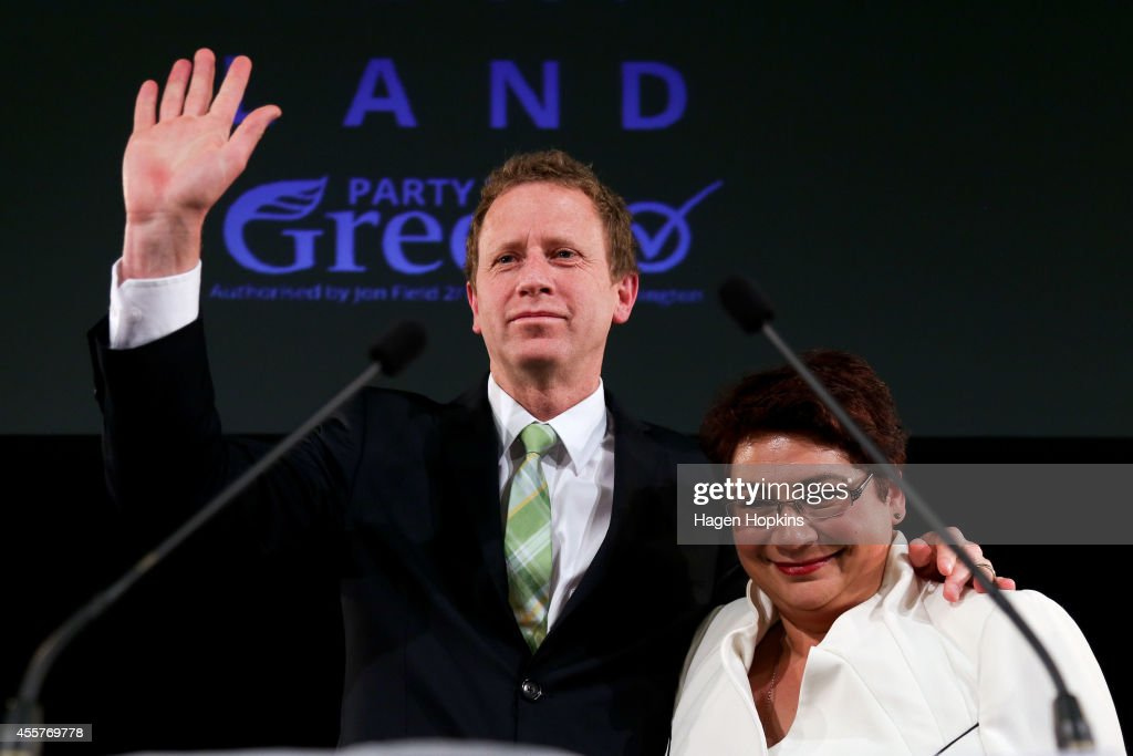 Co-leaders Metiria Turei and Russel Norman salute supporters after making speeches during the Green's 2014 General Election party at Hopetoun Alpha on September 20, 2014 in Auckland, New Zealand. Voters headed to the polls today to elect the 51st Parliament of New Zealand.