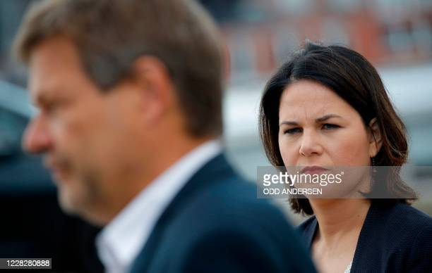 Co-leaders of Germany's Green party Annalena Baerbock and Robert Habeck give a statement as they arrive for a closed meeting with the Greens'...