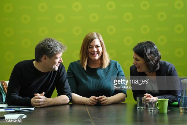 Co-leaders of the German Greens party Annalena Baerbock and Robert Habeck huddle with Greens party Hamburg elections lead candidate Katharina...