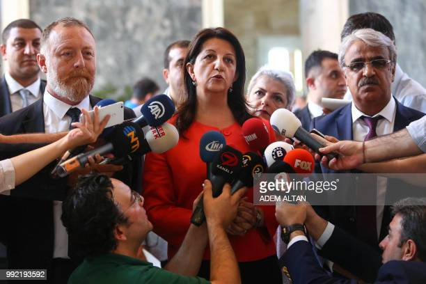Coleaders of the proKurdish Peoples' Democratic Party Sezai Temelli and Pervin Buldan speak to journalists at the parliament in Ankara on July 5 2018...