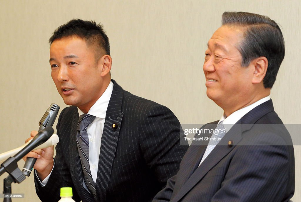 Co-Leaders Taro Yamamoto (L) speaks while Ichiro Ozawa smiles during 'The People's Life Party & Taro Yamamoto And Friends' press conference on January 27, 2015 in Tokyo, Japan.