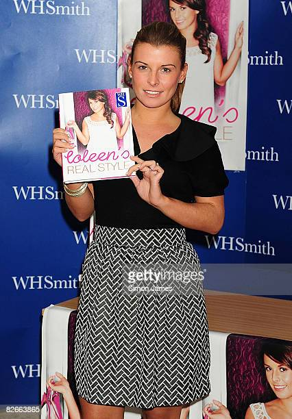 Coleen McLoughlin poses with a copy of her new style guide Coleen's Real Style during a book signing event at WH Smith on September 1 2008 in Grays...